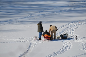 Ice Fishermen Enjoying the Sunny Day