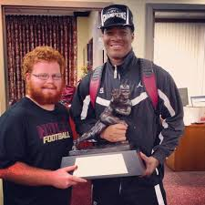 Red with Jameis and the Heisman Trophy